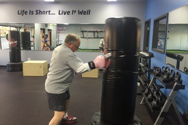 Bootcamp at Living Well Fitness in Northern Kentucky. Jerry on the Punching Bag